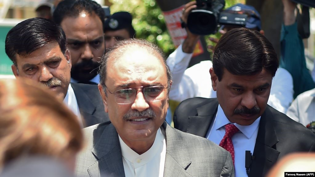 Former president and Pakistan Peoples' Party (PPP) co-chairman Asif Ali Zardari on Monday surrendered himself to a team of the National Accountability Bureau (NAB) after Islamabad High Court (IHC) rejected Asif Ali Zardari and Faryal Talpur's pre-arrest bail plea in the money laundering case. Following the refusal of his pre-arrest bail, a team of the National Accountability Bureau (NAB) accompanied by police personnel had reached the residence of PPP co-chairman Asif Ali Zardari in order to arrest him. PPP chairman Bilawal Bhutto Zardari and Asifa Bhutto were present on the ocassion. The NAB team did not arrest Faryal Talpur though. Asif Zardari was taken to NAB office in Rawalpindi where he was shifted and to cell no 2. The former president will be presented before the accountability court on Tuesday where the NAB will appeal for his remand.